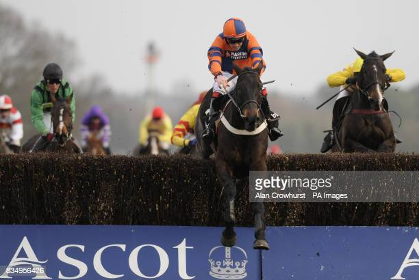 Niche Market and Harry Skelton jump the last to win The BGC Silver Cup Handicap Steeple Chase at Ascot Racecourse Berkshire