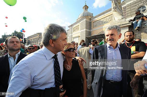 Nichi Vendola Governor of Apulia talks with MP Massimo D'Alema at a demonstration to defend freedom of the press in Italy in the Piazza del Popolo on...