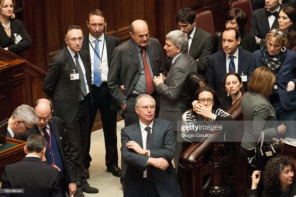 Nichi Vendola (CR), leader of SEL civic list, and <a gi-track='captionPersonalityLinkClicked' href=/galleries/search?phrase=Pier+Luigi+Bersani&family=editorial&specificpeople=4182508 ng-click='$event.stopPropagation()'>Pier Luigi Bersani</a> (CL), leader of the Democratic Party talk as they attend the second meeting of the new Italian Parliament at the Chambers of Deputy on March 16, 2013 in Rome, Italy. The new Italian parliament, which opens the 17th Legislature, has the task of electing the President of the House of Parliament and of the Senate, before giving way to a new government.