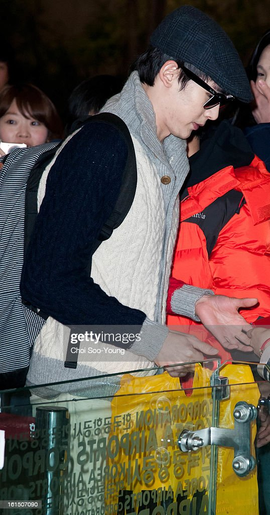 Nich-Khun of <a gi-track='captionPersonalityLinkClicked' href=/galleries/search?phrase=2pm&family=editorial&specificpeople=6362819 ng-click='$event.stopPropagation()'>2pm</a> is seen at Gimpo International Airport on February 11, 2013 in Seoul, South Korea.