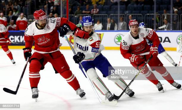 Nichlas Hardt of Denmark challenges Luca Zanatta of Italy for the puck during the 2017 IIHF Ice Hockey World Championship game between Denmark and...