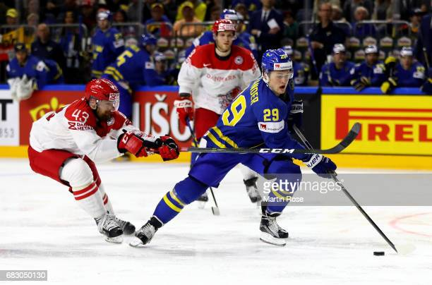 Nichlas Hardt of Denmark challenges William Nylander of Sweden for the puck during the 2017 IIHF Ice Hockey World Championship game between Denmark...