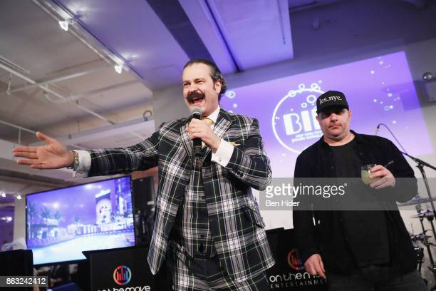 Nicho Lowry and Chris Santos speak onstage during City Harvest's 23rd Annual BID at Metropolitan Pavilion on October 19 2017 in New York City