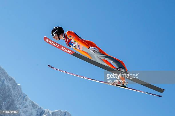 Nicholas Alexander of the United States competes in the first run of flying hill team competition of the FIS Ski Jumping World Cup at Planica on...