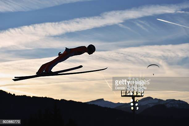 Nicholas Alexander of the United States soars through the air during his competition jump on Day 2 of the 64th Four Hills Tournament event on...
