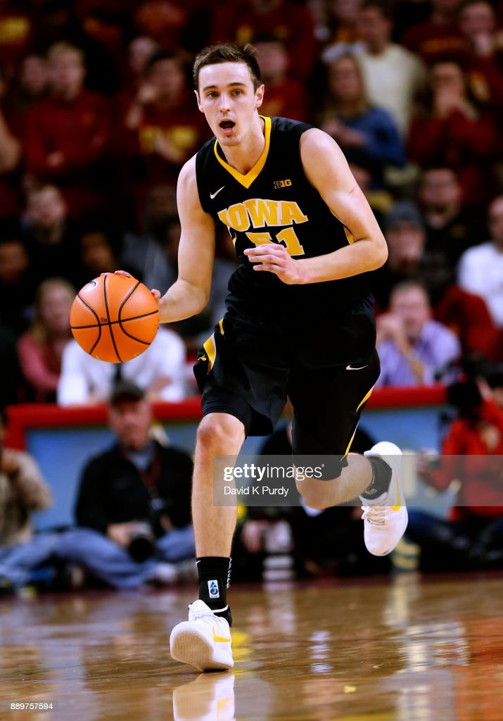 Nicholas Baer #51 of the Iowa Hawkeyes drives the ball in the second half of play against the Iowa State Cyclones at Hilton Coliseum on December 7, 2017 in Ames, Iowa. The Iowa State Cyclones won 84-78 over the Iowa Hawkeyes.