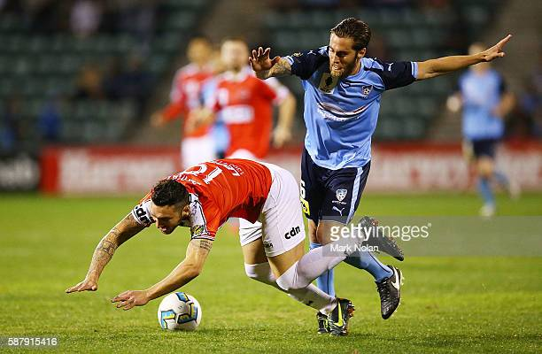 Nicholas Bernal of the Wolves is tackled by Joshua Brillante of Sydney FC during the FFA Cup round of 32 match between the Wollongong Wolves and...