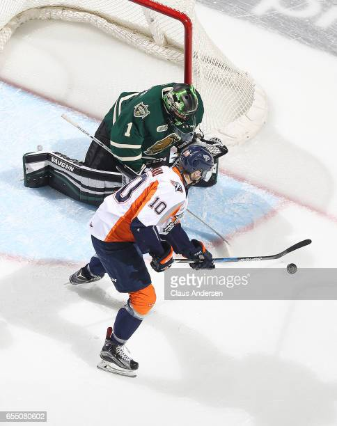 Nicholas Caamano of the Flint Firebirds looks to get a shot at Tyler Parsons of the London Knights during an OHL game at Budweiser Gardens on March...