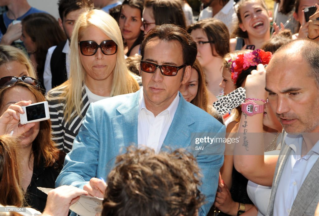 Nicholas Cage pictured surrounded by fans outside Capital radio on July 18, 2013 in London, England.