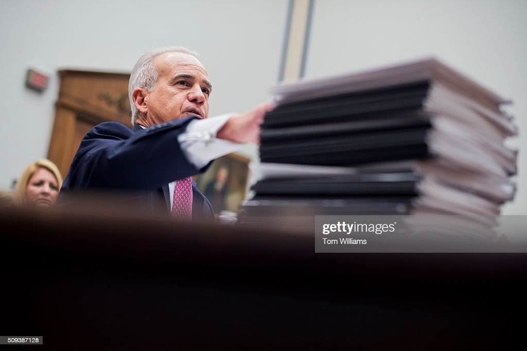 Nicholas Calio, President and CEO of Airlines for America, testifies with a stack of air traffic control reports during a House Transportation and Infrastructure Committee hearing in Rayburn Building on the need to reform the system, February 10, 2016.