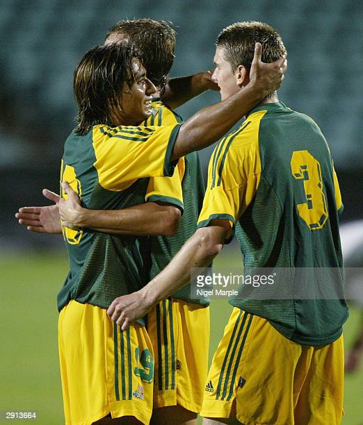 Nicholas Carle celebrates with Shane CansdellSherriff of Australia after winning the Olympic Qualifying match for the Athens Games between New...