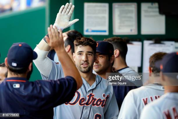Nicholas Castellanos of the Detroit Tigers is congratulated by teammates in the dugout after hitting a tworun home run during the 2nd inning of the...