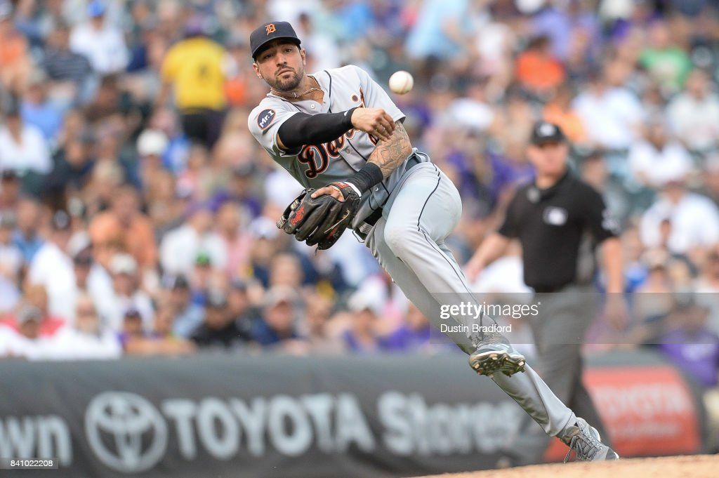 Nicholas Castellanos #9 of the Detroit Tigers throws to first base for an out after fielding a soft ground ball in the sixth inning of a game at Coors Field on August 30, 2017 in Denver, Colorado.