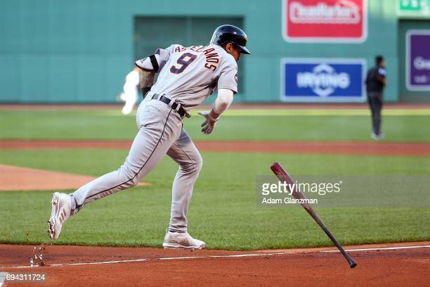 Nicholas Castellanos of the Detroit Tigers tosses his bat after hitting a solo home run in the first inning of a game against the Boston Red Sox at...