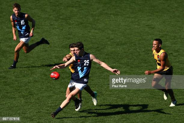 Nicholas Coffield of Vic Metro gets his kick away against Christian Ameduri of Western Australia during the U18 Championships match between Western...