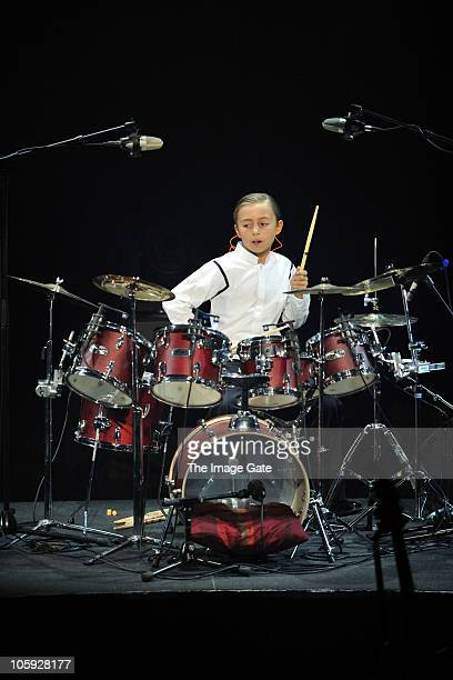 Nicholas Collins plays drums as his father Phil Collins was unable to perform due to his hand condition during the Little Dreams Foundation 10th...