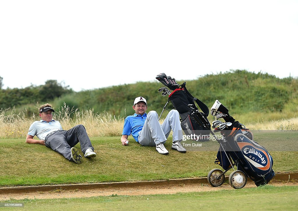 Nicholas Cook (R) and Lee Collings (L) of Lostwithiel Golf & Country Club relax during the Lombard Trophy West Regional Qualifier at Burnham and Berrow Golf Club on July 23, 2014 in Burnham-on-Sea, England.