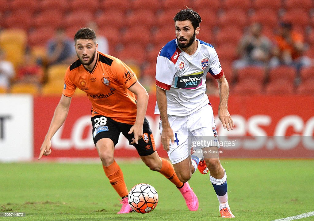Nicholas Cowburn of the Jets is challenged by Brandon Borrello of the Roar during the round 19 A-League match between the Brisbane Roar and the Newcastle Jets at Suncorp Stadium on February 12, 2016 in Brisbane, Australia.