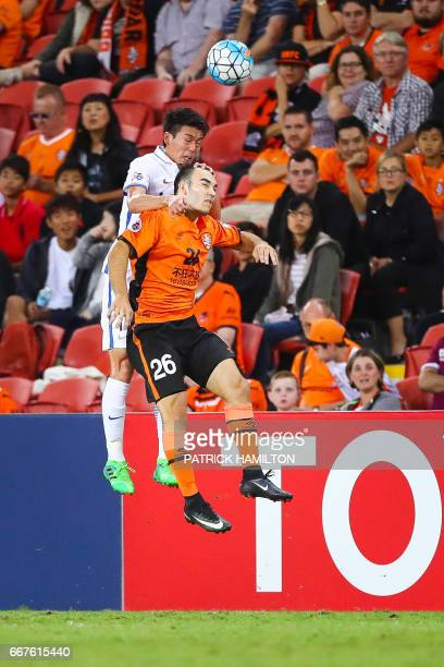 Nicholas D'Agostino of the Brisbane Roar fights for the ball with Shuto Yamamoto of the Kashima Antlers during the AFC Champions League Group...