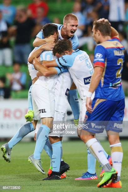 Nicholas Fitzgerald of the City celebrates a goal as Luke Brattan of the City jumps on top during the round 23 ALeague match between Melbourne City...