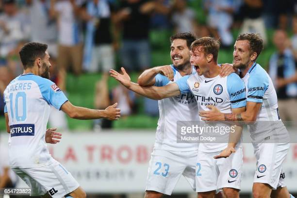 Nicholas Fitzgerald of the City celebrates a goal with Anthony Caceras the City Bruno Fornaroli and Nicholas Colazo during the round 23 ALeague match...