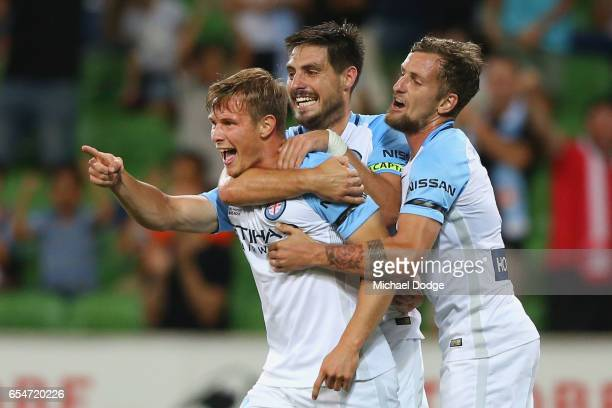 Nicholas Fitzgerald of the City celebrates a goal with Bruno Fornaroli and Nicholas Colazo during the round 23 ALeague match between Melbourne City...