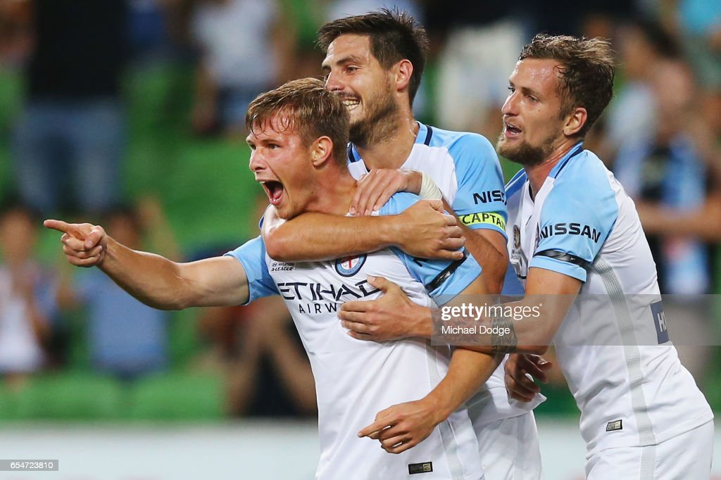 Nicholas Fitzgerald of the City (L) celebrates a goal with Bruno Fornaroli (C) and Nicholas Colazo during the round 23 A-League match between Melbourne City FC and the Newcastle Jets at AAMI Park on March 18, 2017 in Melbourne, Australia.