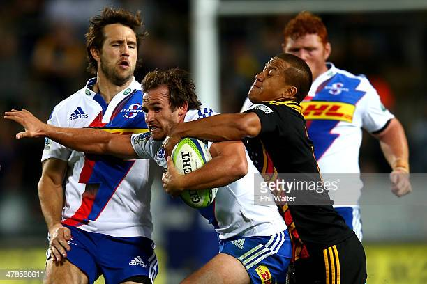 Nicholas Groom of the Stormers is tackled by Tim NanaiWilliams of the Chiefs during the round five Super Rugby match between the Chiefs and the...