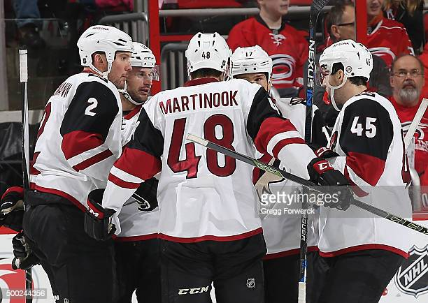 Nicholas Grossman of the Arizona Coyotes celebrates his first period goal with teammates Jordan Martinook Stefan Elliott Steve Downie and Brad...