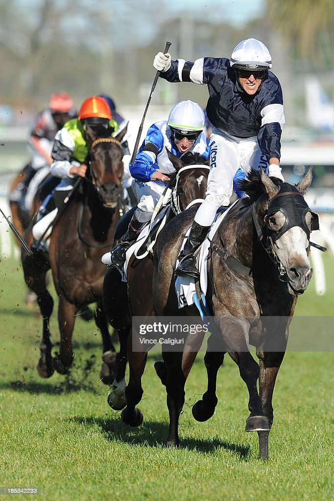 Nicholas Hall riding Fawkner reacts after winning the BMW Caulfield Cup during Caulfield Cup day at Caulfield Racecourse on October 19, 2013 in Melbourne, Australia.
