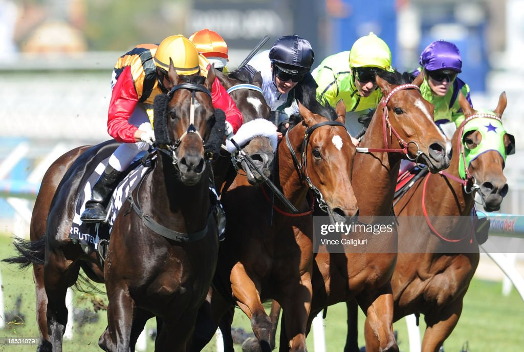 Nicholas Hall riding Spirit of Boom (L) wins the Perri Cutten Caulfield Sprint during Caulfield Cup day at Caulfield Racecourse on October 19, 2013 in Melbourne, Australia.