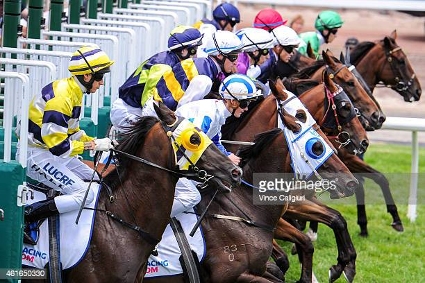 Nicholas Hall riding Who Says I'm Ready and Regan Bayliss riding Kept Women jump out of barriers in Race 1 during Melbourne Racing at Flemington...