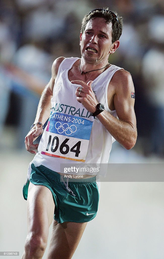 Nicholas Harrison of Australia enters the stadium before finishing the men's marathon on August 29, 2004 during the Athens 2004 Summer Olympic Games at Panathinaiko Stadium in Athens, Greece.