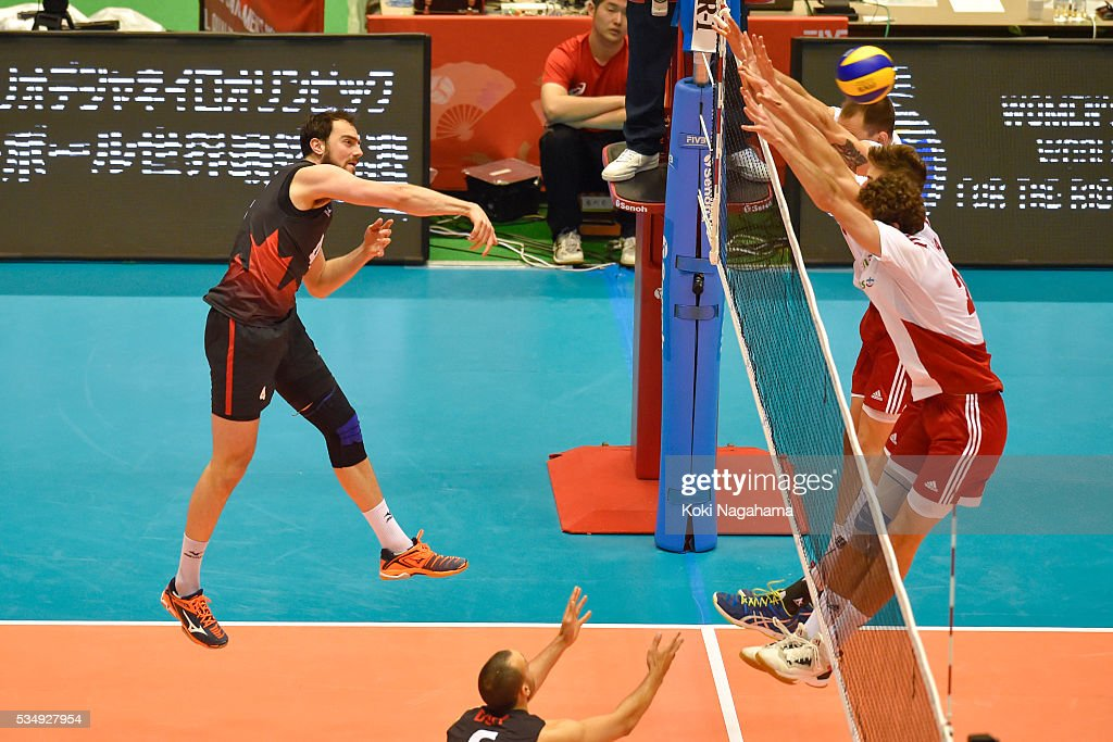 Nicholas Hoag #4 of Canada spikes the ball during the Men's World Olympic Qualification game between Poland and Canada at Tokyo Metropolitan Gymnasium on May 28, 2016 in Tokyo, Japan.
