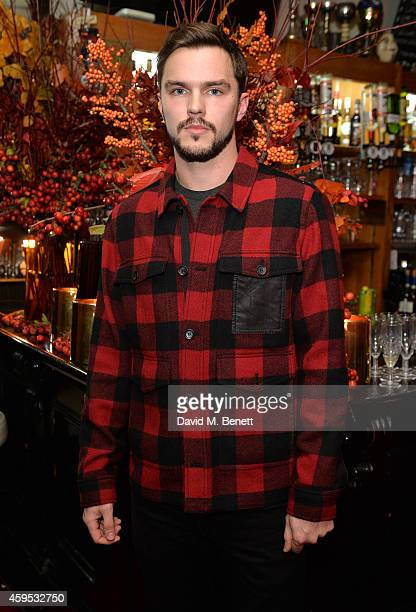 Nicholas Hoult attends the Thanksgiving dinner with Coach hosted by Zoe Kravitz and Mary Charteris on November 24 2014 in London England