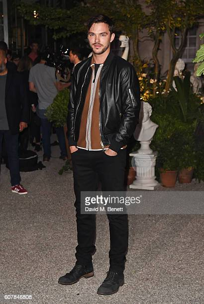 Nicholas Hoult wearing Burberry at the Burberry September 2016 show during London Fashion Week SS17 at Makers House on September 19 2016 in London...
