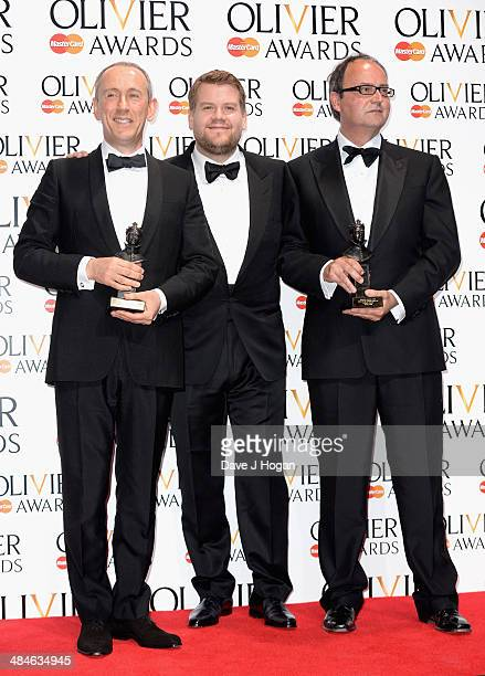 Nicholas Hytner and Nick Starr with their Special award and award presenter James Corden during the Laurence Olivier Awards at the Royal Opera House...
