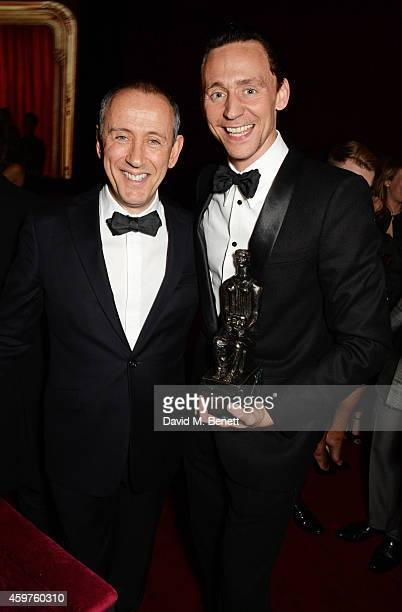 Nicholas Hytner and Tom Hiddleston winner of the Best Actor award for 'Coriolanus' attend an after party following the 60th London Evening Standard...