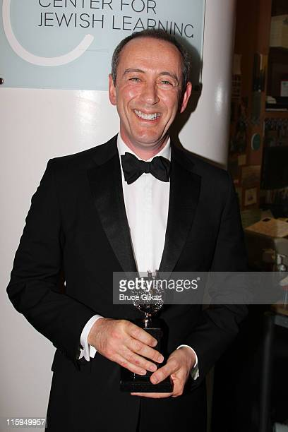 Nicholas Hytner poses with the award for Best Play in the press room during the 65th Annual Tony Awards at the The Jewish Community Center in...