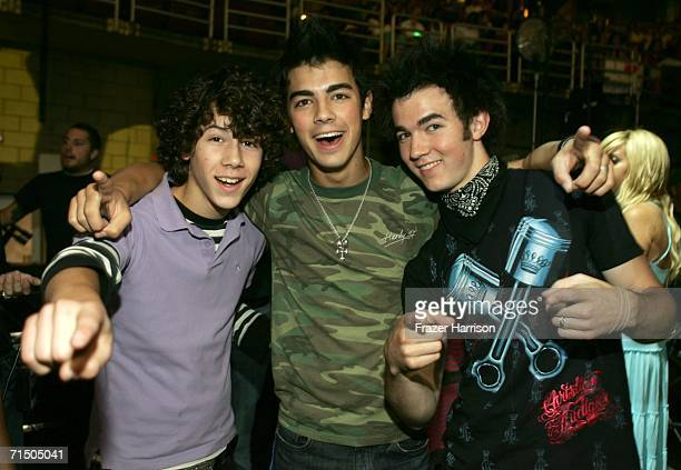 Nicholas Jonas Joseph Jonas and Kevin Jonas of The Jonas Brothers pose backstage at the Radio Disney Totally 10 Birthday Concert held at the...