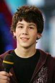 Nicholas Jonas of The Jonas Brothers appears onstage during MTV's Total Request Live at the MTV Times Square Studios March 1 2006 in New York City