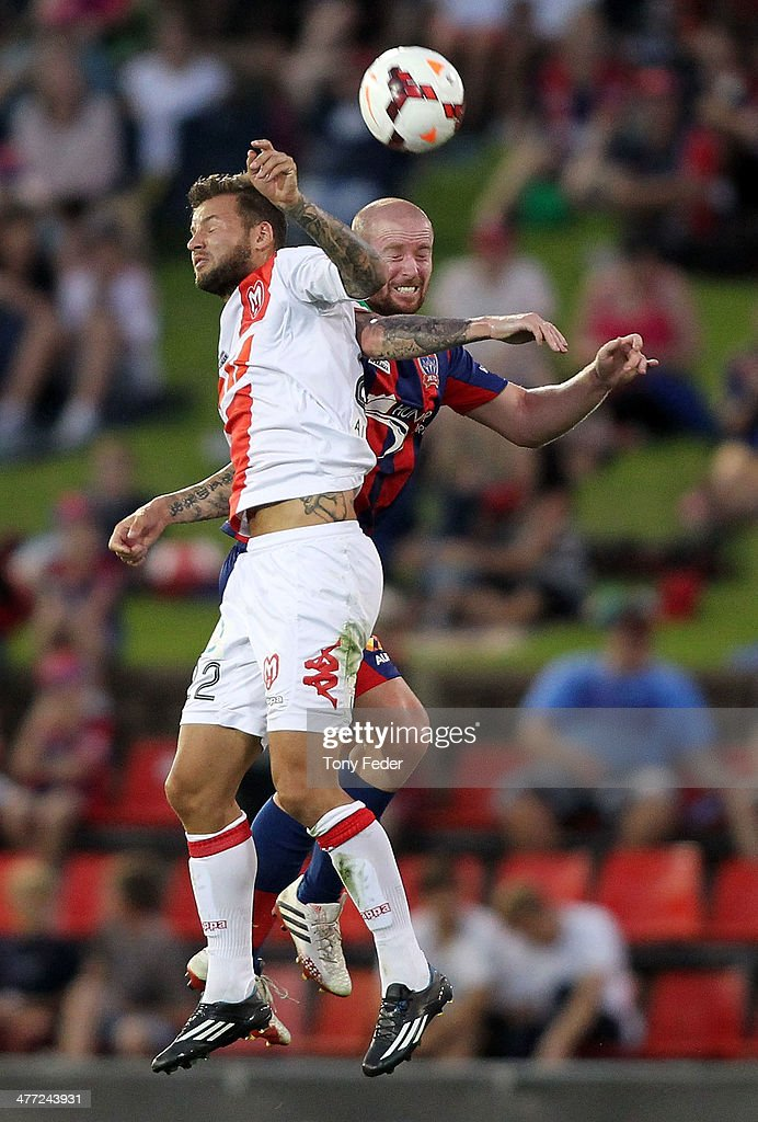 Nicholas Kalmar of the Heart contests the header against David Carney of the Jets during the round 22 A-League match between the Newcastle Jets and Melbourne Heart at Hunter Stadium on March 8, 2014 in Newcastle, Australia.