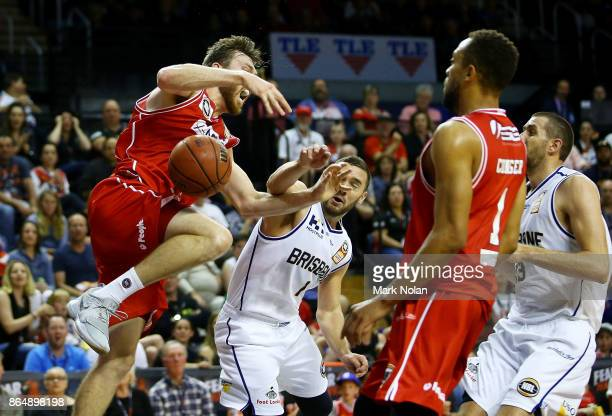 Nicholas Kay of the Hawks is fouled by Adam Gibson of the Bullets during the round three NBL match between the Illawarra Hawks and the Brisbane...