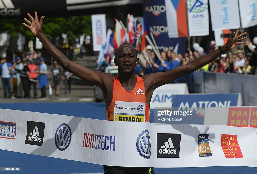 Nicholas Kemboi of Qatar celebrates winning as he crosses the finish line after competing in the Volkswagen Prague Marathon in the Czech capital on May 12, 2013. AFP PHOTO / MICHAL CIZEK