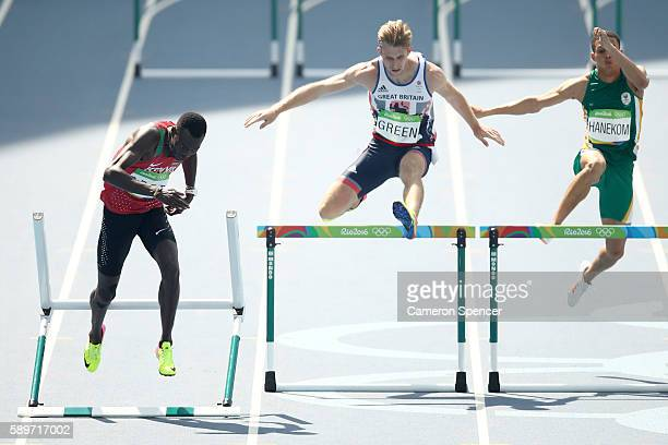 Nicholas Kiplagat Bett of Kenya Jack Green of Great Britain and Lindsay Hanekom of South Africa compete in round one of the Men's 400m Hurdles on Day...