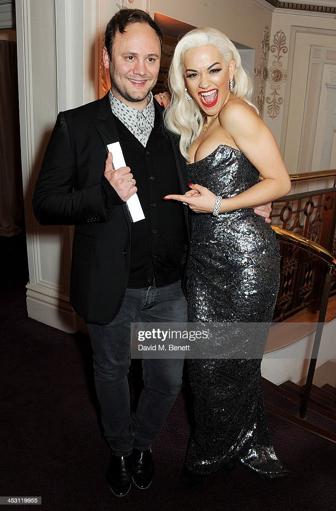 Nicholas Kirkwood (L), Accessory Designer of the Year, and <a gi-track='captionPersonalityLinkClicked' href=/galleries/search?phrase=Rita+Ora&family=editorial&specificpeople=5686485 ng-click='$event.stopPropagation()'>Rita Ora</a> pose at the British Fashion Awards 2013 at London Coliseum on December 2, 2013 in London, England.