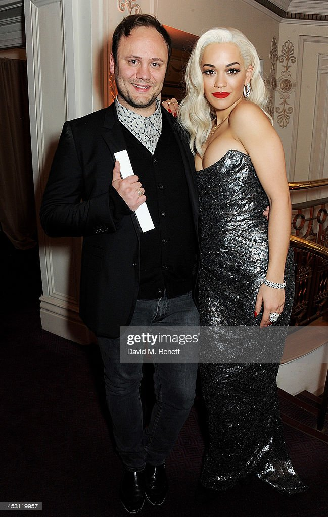 Nicholas Kirkwood (L), Accessory Designer of the Year, and Rita Ora pose at the British Fashion Awards 2013 at London Coliseum on December 2, 2013 in London, England.