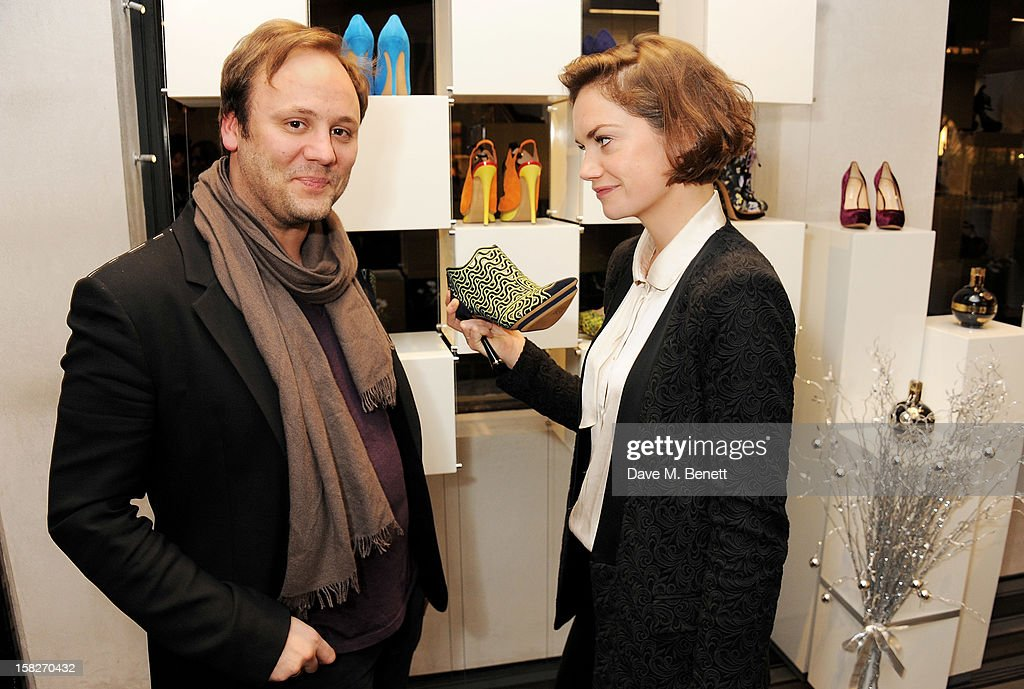Nicholas Kirkwood (L) and Ruth Wilson attend a Christmas drinks hosted by designer Nicholas Kirkwood to celebrate his partnership with Chambord black raspberry liquer, and launch the limited edition shoe 'The Chambord' at the Nicholas Kirkwood Mount Street store on December 12, 2012 in London, England.