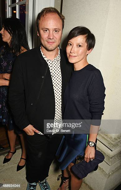 Nicholas Kirkwood and Sandra Choi attend the London Fashion Week party hosted by Ambassador Matthew Barzun and Mrs Brooke Brown Barzun with Alexandra...