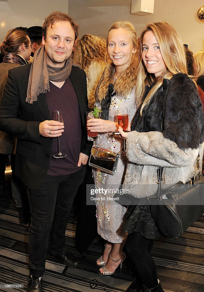 Nicholas Kirkwood, Martha Ward and Ashley Warwa attend a Christmas drinks hosted by designer Nicholas Kirkwood to celebrate his partnership with Chambord black raspberry liquer, and launch the limited edition shoe 'The Chambord' at the Nicholas Kirkwood Mount Street store on December 12, 2012 in London, England.